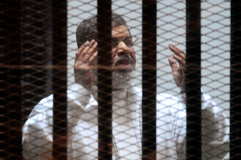 Image: Trial of ousted Egyptian President on charges of spying for Qatar recommences