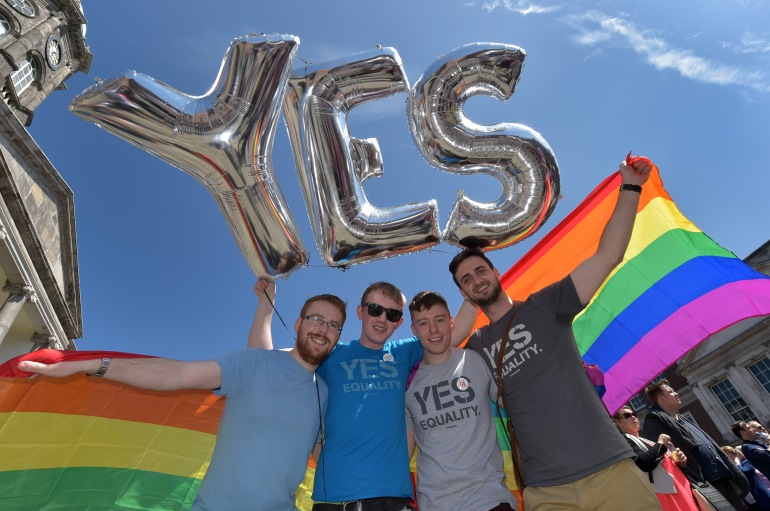 DUBLIN, IRELAND - MAY 23:  Supporters in favour of same-sex marriage pose for a photograph as thousands gather in Dublin Castle square awaiting the referendum vote outcome on May 23, 2015 in Dublin, Ireland. Voters in the Republic of Ireland are taking part in a referendum on legalising same-sex marriage on Friday. The referendum was held 22 years after Ireland decriminalised homosexuality with more than 3.2m people being asked whether they want to amend the country's constitution to allow gay and lesbian couples to marry.  (Photo by Charles McQuillan/Getty Images)