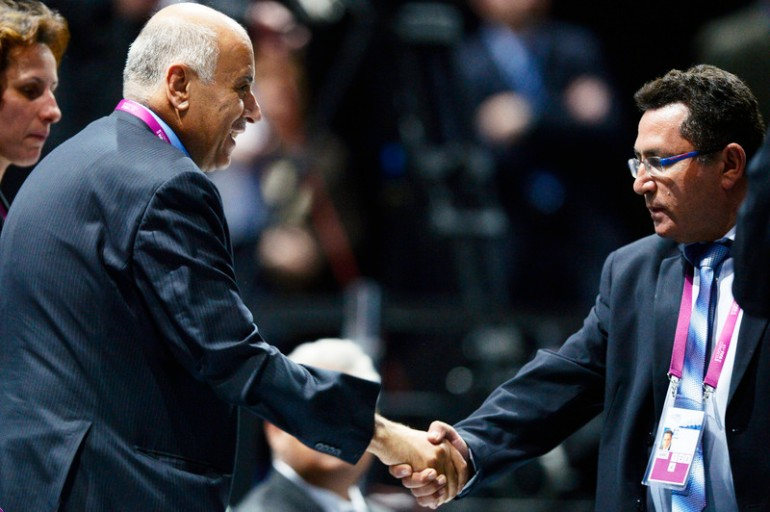 epa04774117 Jibril Rajoub (L), President of the Palestinian Football Association (PFA), shakes hands with Ofer Eini (R), President of the Israeli Football Association (IFA), during the 65th FIFA Congress at the Hallenstadion in Zurich, Switzerland, 29 May 2015. The PFA dropped a motion to suspend Israel at the FIFA congress, its president Jibril Rajoub tells the delegates of the ruling body. The FIFA Congress will elect the FIFA president.  EPA/WALTER BIERI